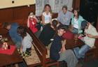 spící Thawicek a natočená trinity1601, zleva do prava okolo stolu: ousama, záda HARTSON_JOHN, fotografka ganja.161, Zuza91, Happy-Gilmore, WiTL, Artanis-ekl